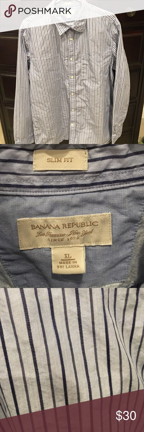 Men's Banana Republic slim fit dress shirt The men's Banana Republic slim fit dress shirt has never been worn. It is a button down dress shirt. The colors are blue with dark blue stripes. Banana Republic Shirts Dress Shirts