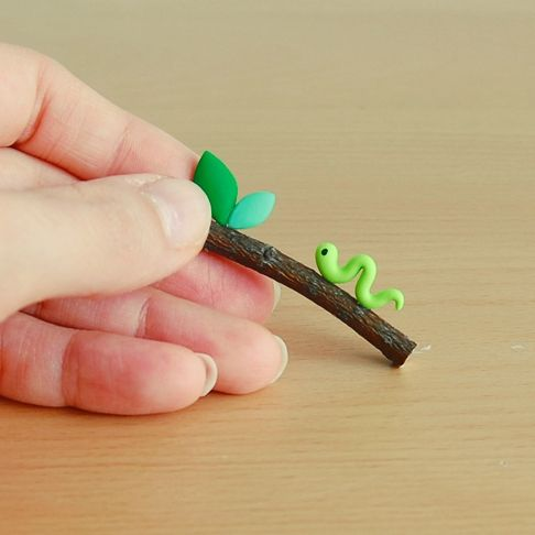 It'd be cute as a necklace, like an eyepin on each end of the stick! need to try this, just don't know how to make the tree