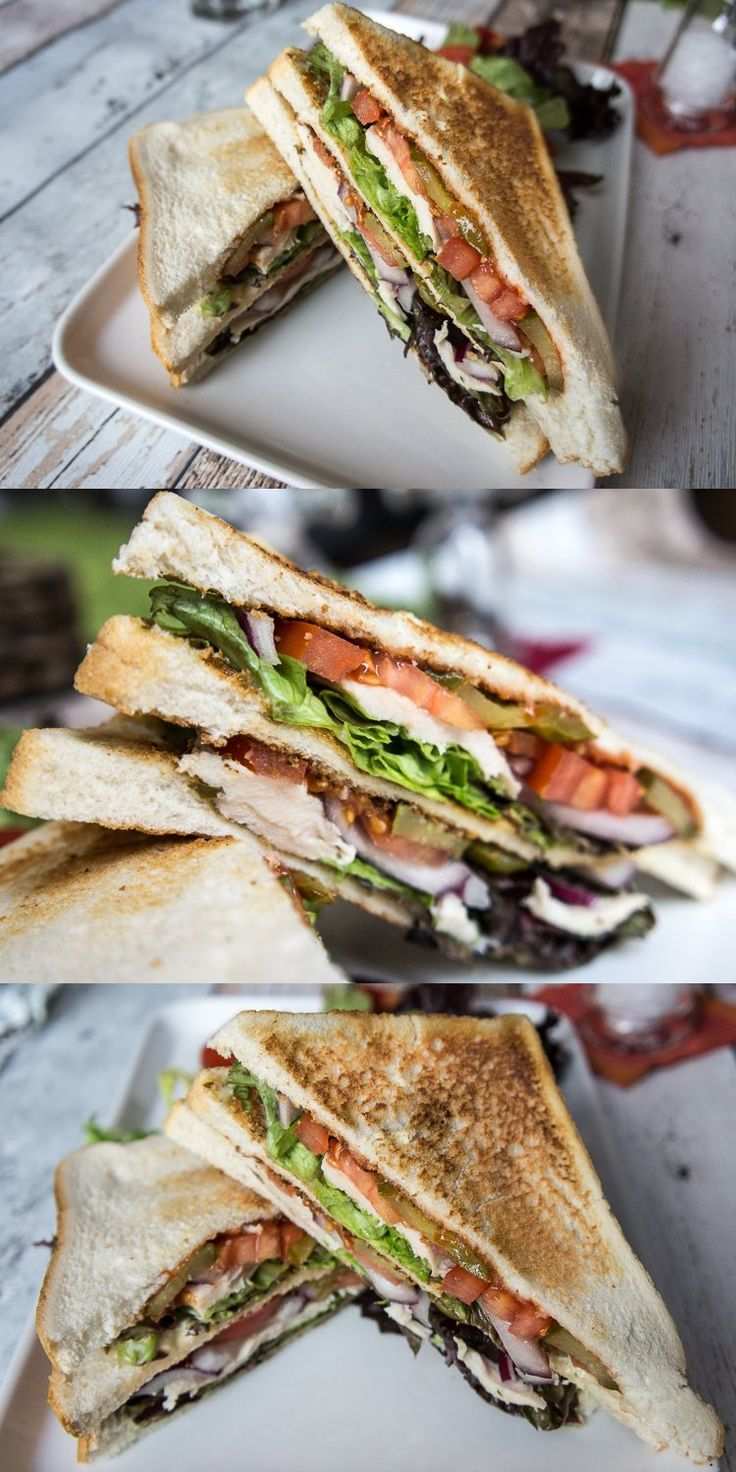 Club sandwich with chicken breast, tomatoes, mayo, pickles and lettuce
