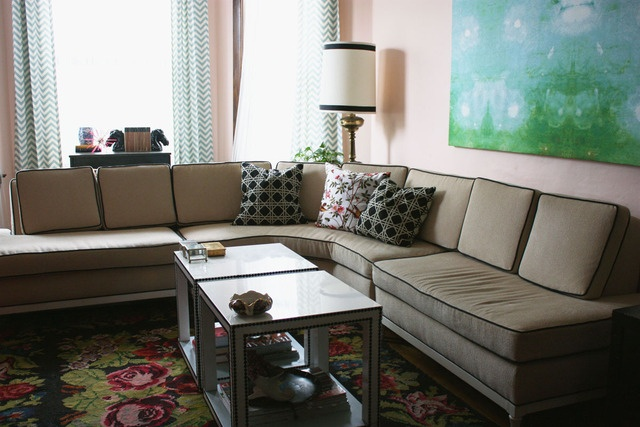 muted with brights.  eclectic midcentury modern: piped tan sofa, bright green and blue hues, muted vintage rug, ikea hacks.