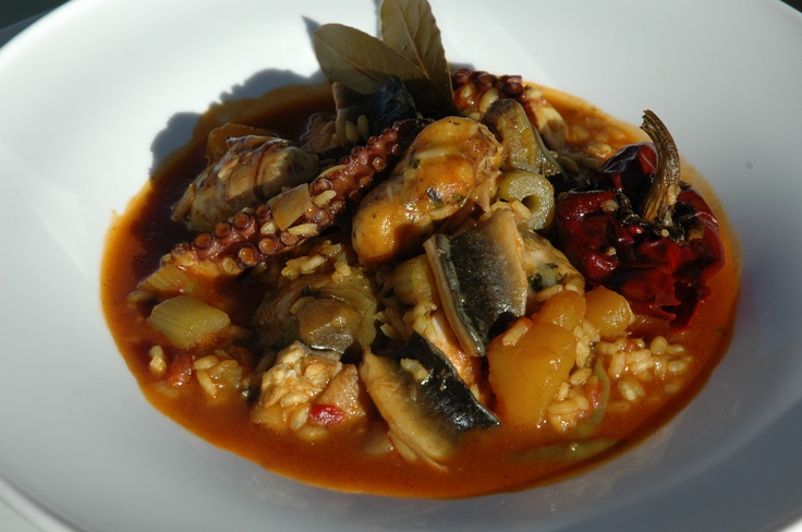 Descomunal arroz meloso de pulpo, anguila y figatells de escórpora. Casa Salvador - L'Estany de Cullera