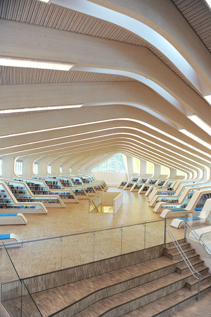 Norwegian Library--Norwegian architecture firm Helen & Hard, led by architects Siv Helene Stangeland and Reinhard Kropf, adjoined an existing community house, learning center, and public space to create the Vennesla Library and Cultural Center.