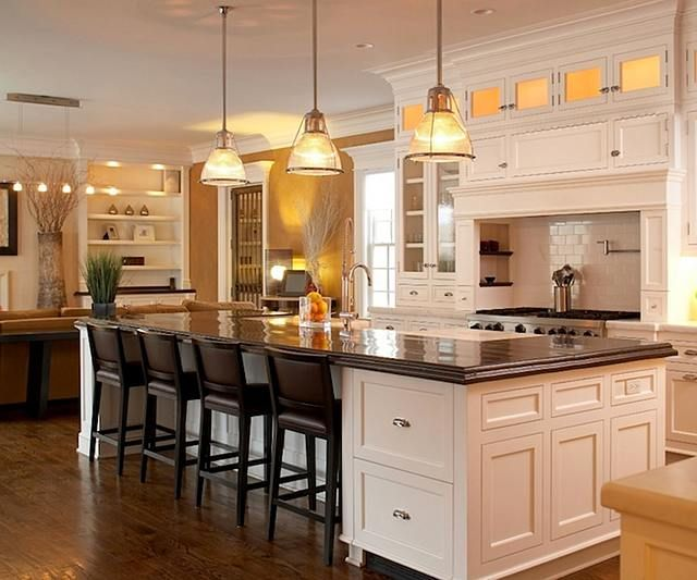 All White Kitchen With Dark Stained Countertop On Island