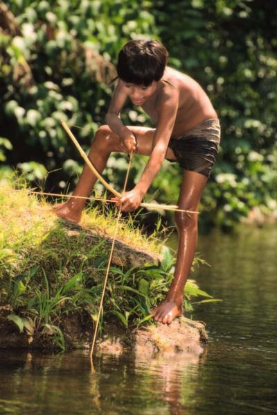 Boy From The Yanomami Tribe Of Brazil Bow Fishing Sue S