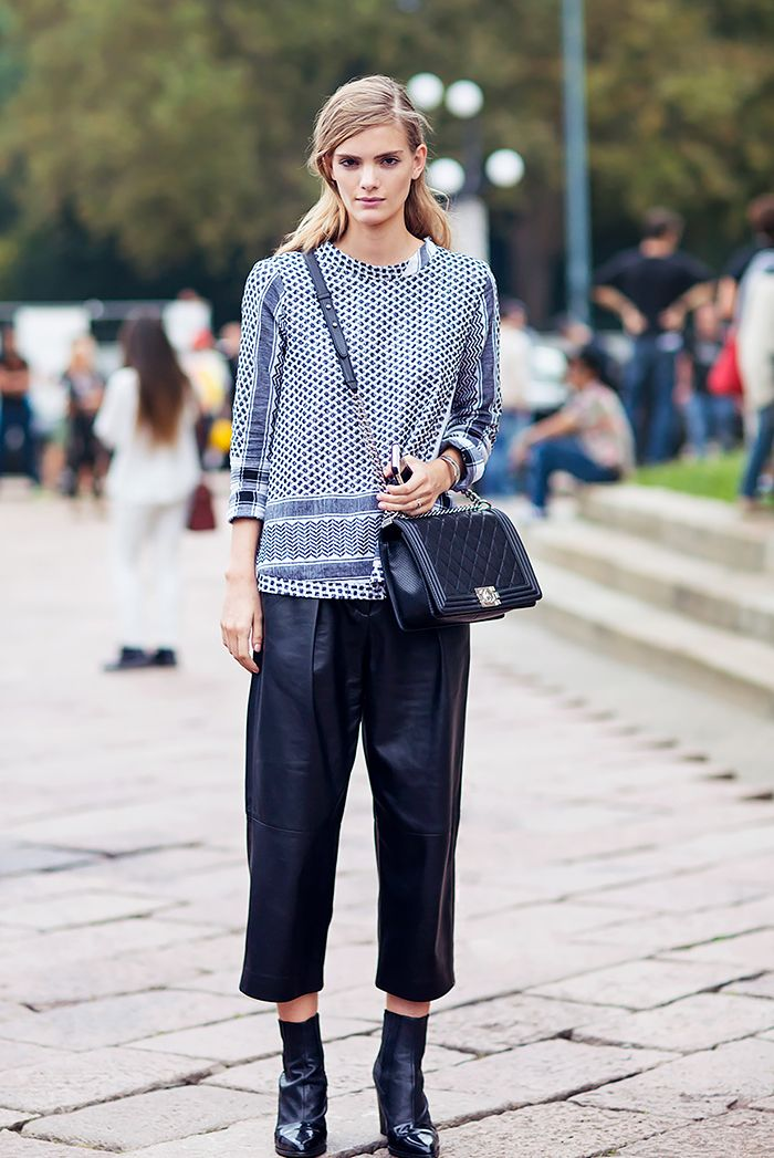Printed top, leather culottes, and black ankle boots