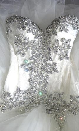 None other than Pnina Tornai - Okay I think marriage is stupid, but if I were ever to participate in such madness, I would wear Pnina.  Period.