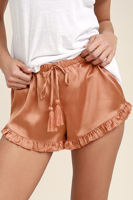 Lounge about and sleep tight in the Night Night Copper Satin Shorts! An elasticized, drawstring waistband, with tassels, tops these lightweight, satin shorts with dainty, ruffled hems.