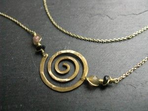 Classic spiral, minimal interlock  geometric necklace in golden brass