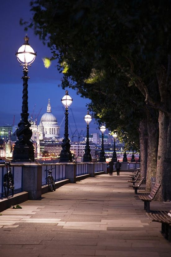 The Queens walk along the River Thames with Saint Pauls Cathedral in the background, London