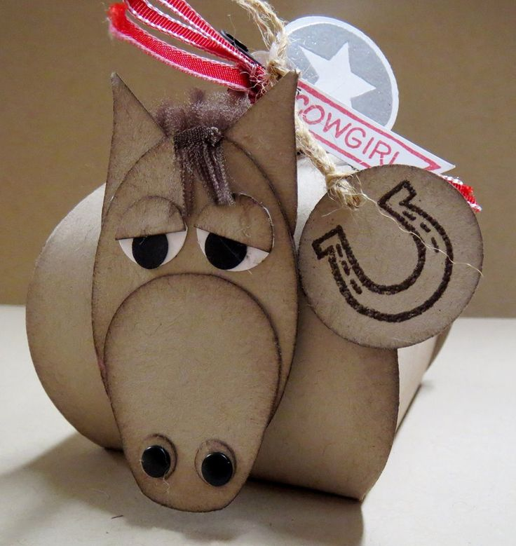 """This is too cute!!! head Extra Large Oval punch & Owl Builder punch trim the feet and horns off, the ears Sweetheart punch, cut in half,pointy end up. Eyes are circle punches the 1/2"""" circle punch and the 1/4"""" circle punch, nostrils are 1/4"""" circle and candy dots, the forelock and mane are made from the 1/2"""" Seam Binding in Early Espresso,cut a piece about 1"""" long and trimmed the very edge of the long side off, then I pulled the horizontal threads out, layered some in back and one in front,"""