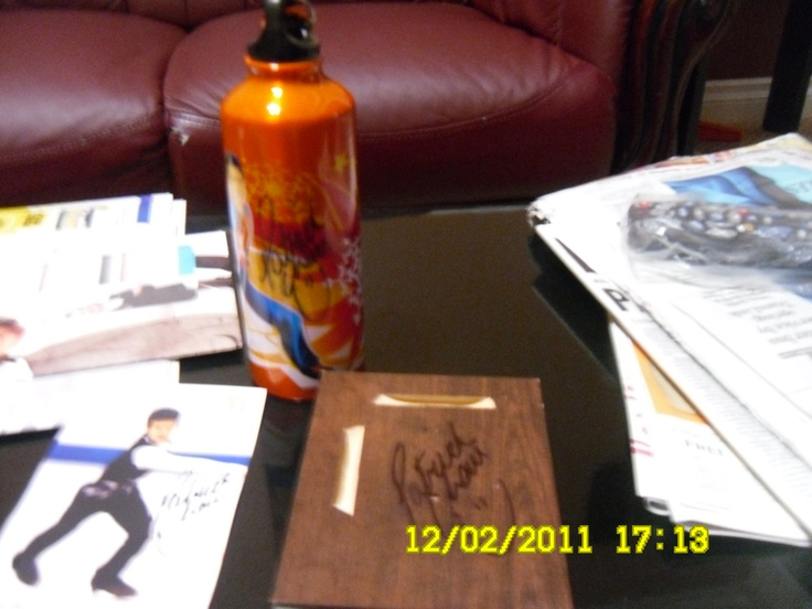 the things i got signed by Patrick Chan when he came to vancouver for a signing! Was pouring rain and got soaked, but was all worth it!
