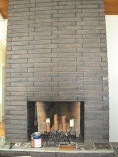 Instead of cleaning or painting brick — stain your brick fireplace with concrete stain // retro renovation