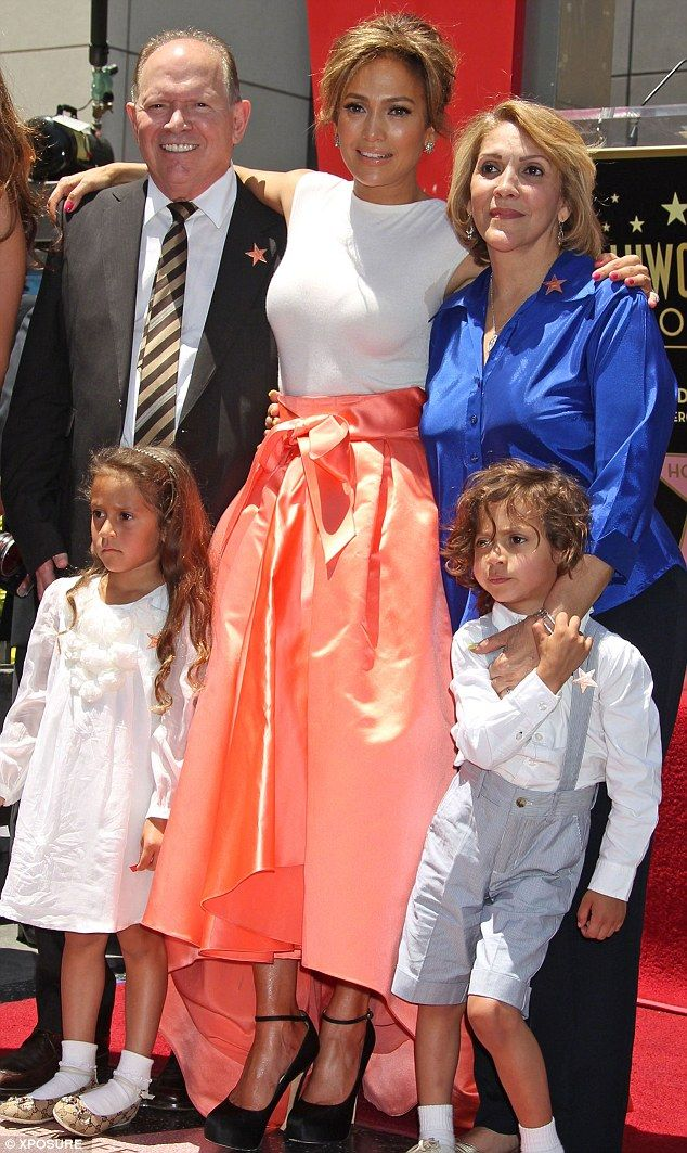 The whole clan: Jennifer Lopez posed with her mother, father David Lopez and her two twins, Max and Emme, when she got her star on the Hollywood Walk Of Fame last month