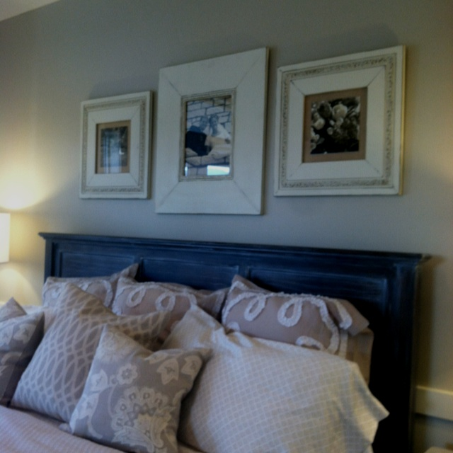 Love the picture frames above the bed.