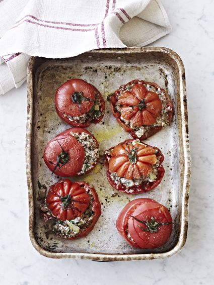 stuffed baked tomatoes with barley, celery, herbs, parmesan and fresh cheese