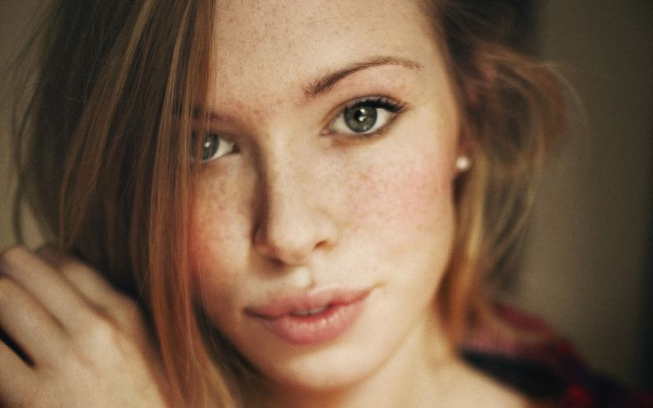 Red Hair Models | Close-up photo of a red hair model with freckles