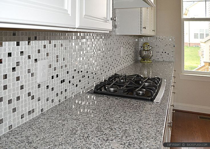 Luna Pearl Granite Countertop With White Glass Metal Kitchen Backsplash Tile  And White Kitchen Cabinets.