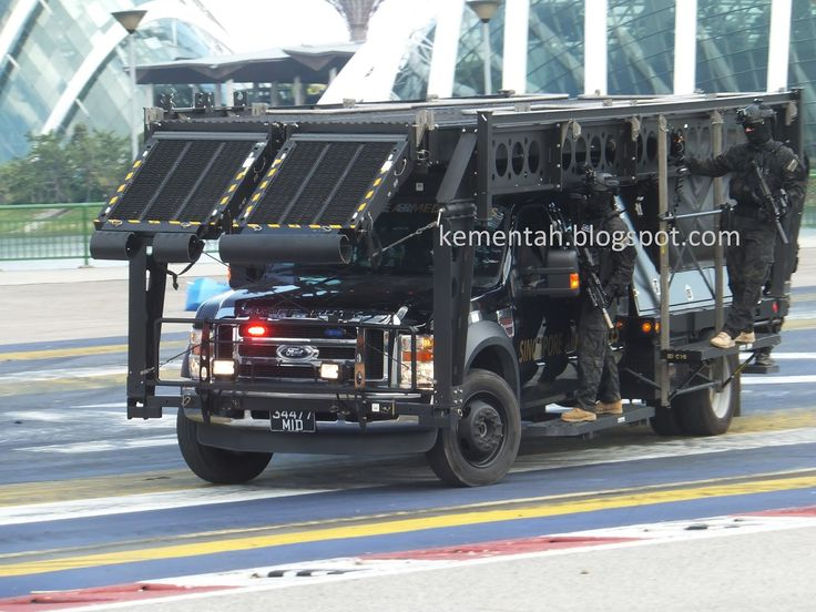 The Special Operations Force demonstrate how they mount up on a Ford vehicle equipped with the Mobile Adjustable Ramp System (MARS) and Side Assault System (SAS). The vehicle is one of the few left-hand drive vehicles in the Singapore Armed Forces inventory.