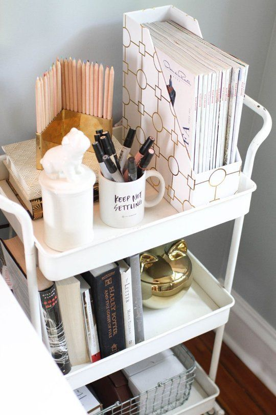 Here's a fresh idea for the workspace: incorporate a bar cart for portable organization that doubles as a display piece!