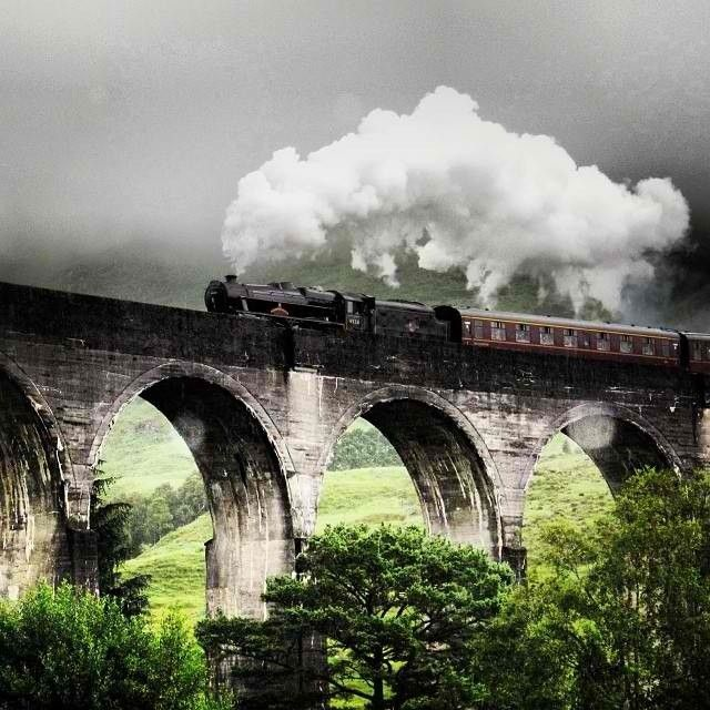 The Jacobite Steam train crossing the #Glenfinnan Viaduct in #Scotland. MUST DO.