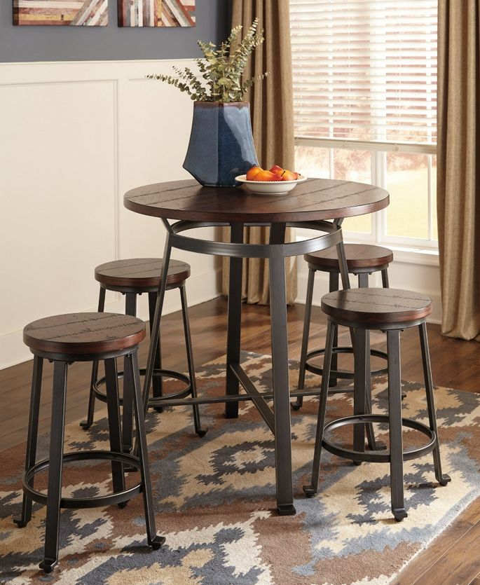 Combining rustic industrial aesthetics stunning counter height pub table set with brown wood planked pine veneer over blackened pewter tubular industrial metal base.