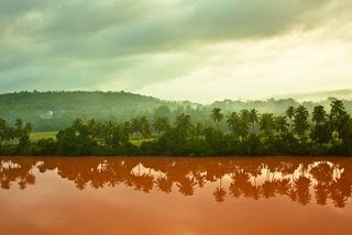 Natural colors of India. Shot in the morning after rains flooded the Aghanashini River (Kumta, India). The laterite soil added the color red to the river. #ridecolorfully