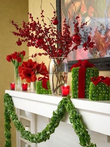 "Wow party guests with a mantel of green flower ""presents"" and fresh red flowers. Use pearl-top straight pins to attach green-tinted mini mums to foam squares, then tie on red velvet ribbon bows. Accent the scene with glass vases filled with red tulips, amaryllis heads and berry branches"