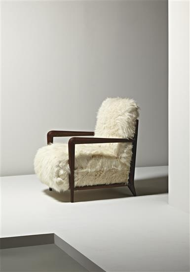 JEAN ROYÈRE Rare armchair, ca. 1936  Stained oak, hide. 33 1/2 in. (85.1 cm.) high Manufactured by Gouffé, France.