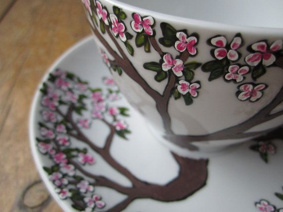 Hand painted cherry blossom tea cup and saucer via Etsy