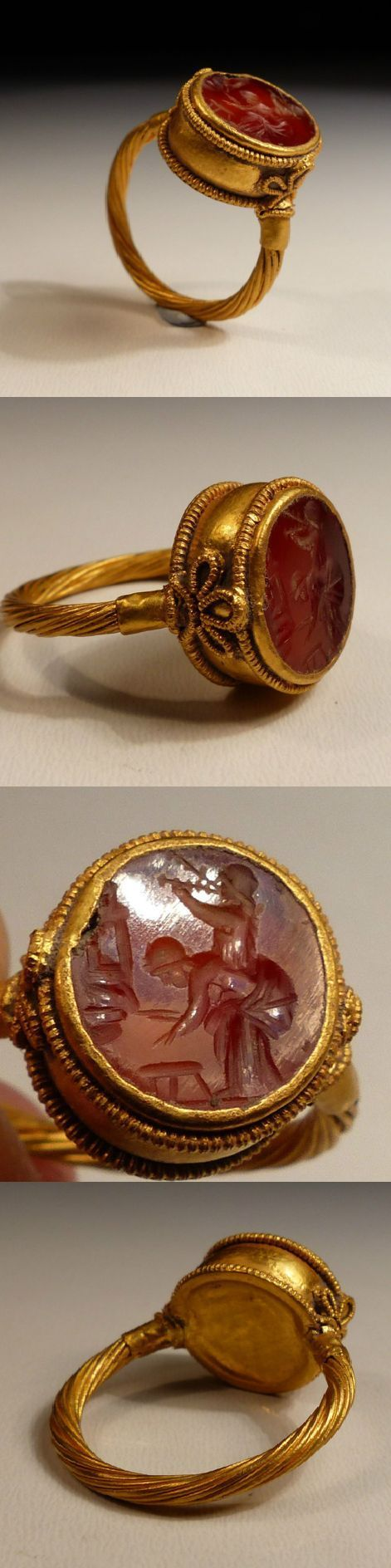 Roman Gold Ring, comprising of a band crafted with twisted gold strands representing a torque supporting a deep circular bezel decorated with fine filigree, set with a beautifully carved carnelian intaglio, dating to the 2nd/3rd Century AD