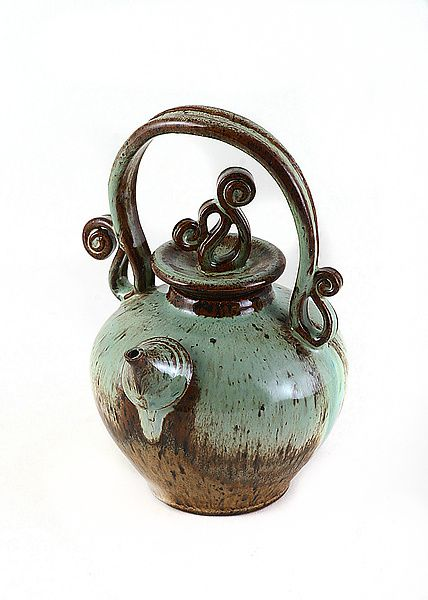 Natural Teapot by Carol Tripp Martens: Ceramic Teapot available at www.artfulhome.com Glaze is sprayed on in several layers of the first color, then over-sprayed on the rim and lightly down the sides for a natural layered look.