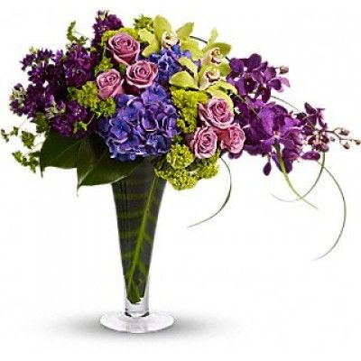 The tropical, feminine bouquet is especially perfect in a modern home, or as impressive office d�cor and #Bountiful_blooms including purple hydrangea, green cymbidium orchids and purple stock are elegantly mixed with greens.