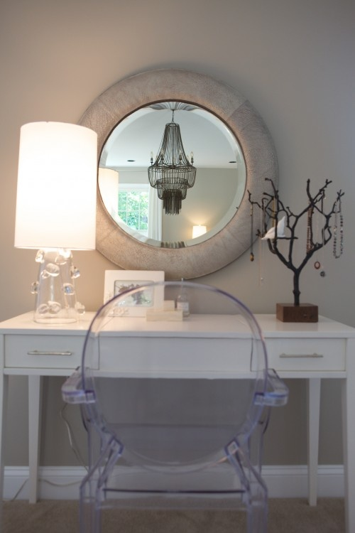 Cow hide mirror... great dressing table and love the lucite chair!!