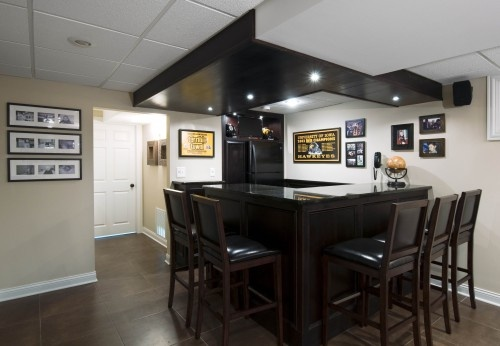 A basement full of Steelers Memorabilia.    Aurora, Il -- Basement Design and Remodel contemporary media room