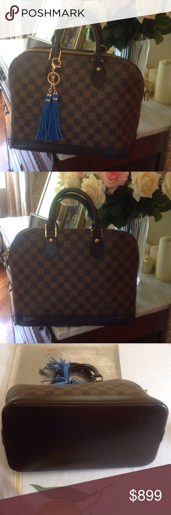 Authentic Louis Vuitton Alma Damier ebene Stunning bag! Lovely condition!  FL 1029 date code. This is one of the most elegant Vuitton styles Louis Vuitton Bags Satchels