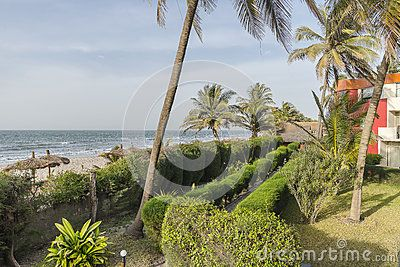 Sunbeds on the tropical beach on the Atlantic Ocean. Hotel in Gambia . Africa