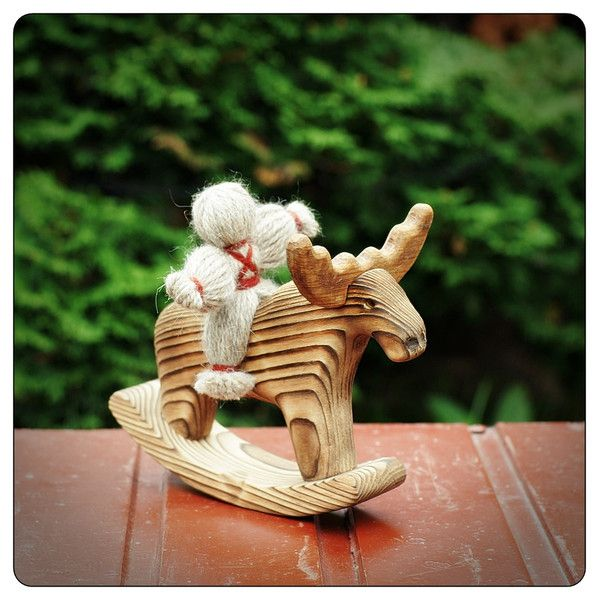 Handmade wooden toy. Pretty little wooden moose with rider!  Design is based on folk toys.  Length: 18cm (7'') Height: 14 cm (5.5'') Material: burned pine wood, oak wood horns, non-toxic...