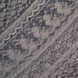 Black polyester mesh featuring an ivory lace design printed on the bias. Ample crosswise stretch. Cute for tops and dresses.