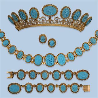 A RARE ANTIQUE PRESSED GLASS PARURE   The parure comprising a tiara with two mounts, a pair of bracelets, a necklace and a pair of earrings, each composed of a row of blue pressed glass cameo's variating in size, depicting philosophers, classical gods and various scenes after the antiques, within borders of cannetille work and filigree mounts, French, circa 1800, fitted case