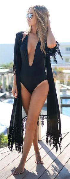 This risqué low plunging swimming costume under a fringed kimono is such a striking outfit. Via Nette Nestea Swimsuit: ASOS, Kimono: MinkPink