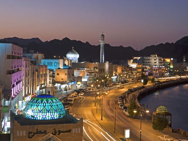 Lights brighten twilight along the Corniche in Matrah, an important seaport in Musqat province. Oman is enjoying a modern renaissance, luring visitors with first-class hotels, views, and entertainment.