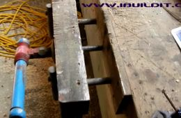 Woodworking Vise - Homemade woodworking vise constructed from lumber, threaded rod, T-fitting, nuts, and bar stock.