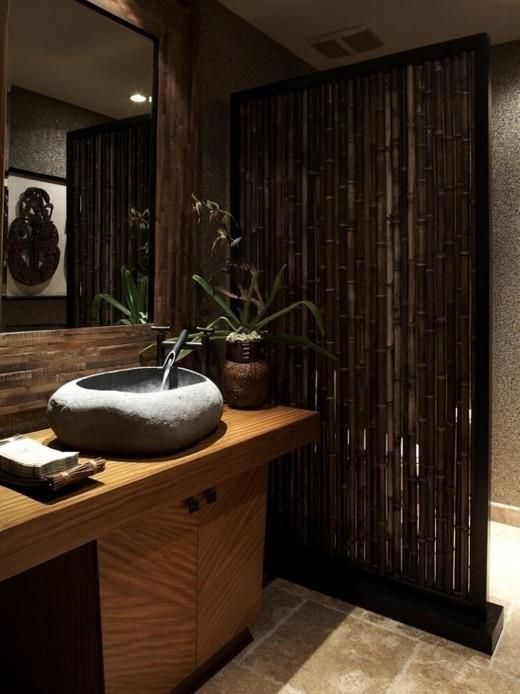 Yesterday we showed you a staircase with a bamboo balustrade, with some of you suggesting it would make a good room divider.    Well, here it is, being used for just that purpose in a bathroom.