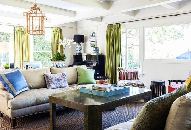"""In the living room, Yager opted for a """"chinoiserie overload""""—bamboo lanterns by John Rosselli and plenty of blue-and-white ceramics—letting the Asian influence complement the home's Craftsman bones."""