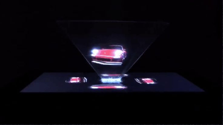 "Porsche would like you to buy a new 911. In order to convince you of that, it has created ""the world's first interactive hologram print ad."" Now, it's not exactly a ""hologram print ad."" It's a..."