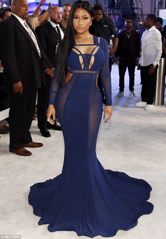 The not-so-little mermaid: She showcased her generous curves in the daringly tight dress