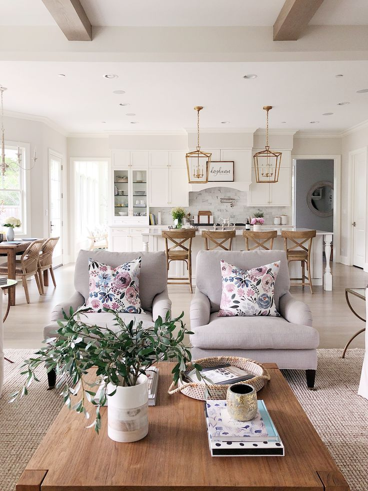 Neutral Living Room With Grey Side Chairs Pottery Barn Wool Jute Rug Wood Square Coffee Tabl Pottery Barn Living Room Farm House Living Room Living Room Grey