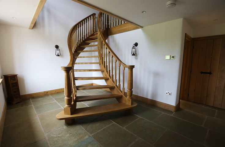 my fave bit of the house, entrance hall, curved and splayed oak staircase, lime stone flagstones, wrought iron wall lights