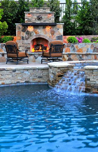 Outdoor fireplace with hot tub and waterfall into a pool. Ahhhhhh!