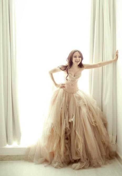 Normally not a fan of ballroom dresses but I love the messy tulle